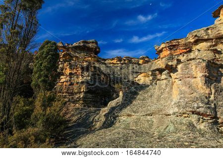 Brilliant blue sky is the backdrop to the Gardens of Stone rock formations in NSW, Australia