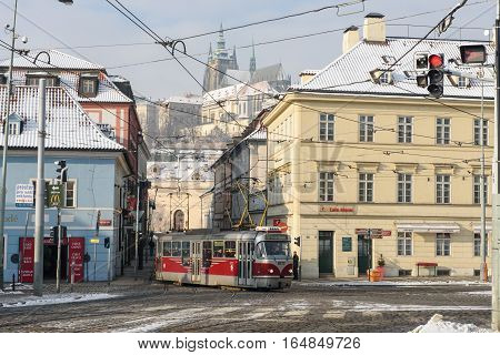 Prague, Czech Republic, 19 January 2016. The tram rides through the streets of Prague winter morning.