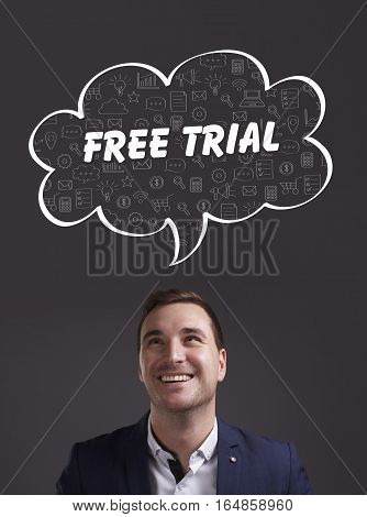 Business, Technology, Internet And Marketing. Young Businessman Thinking About: Free Trial