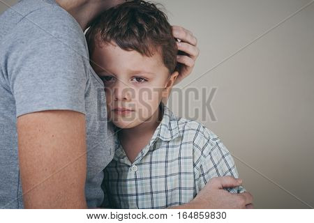 Sad Son Hugging His Mother At Home.