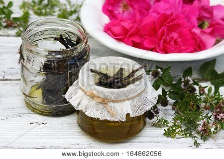 Alternative medicine remedy oil from curative herbs with essential oil from scented flowers