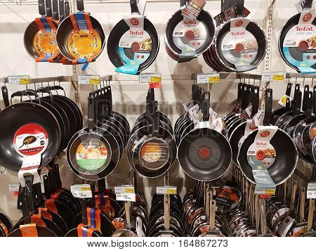CHIANG RAI THAILAND - NOVEMBER 29 : various brand of stainless steel pans in packaging for sale on supermarket stand or shelf on November 29 2016 in Chiang rai Thailand.