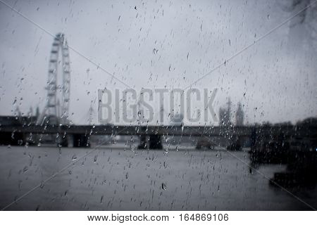 Raindrops On Glass With Blured London Skyline At The Background
