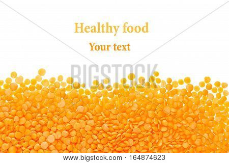 Border of red purified lentil closeup with copy space on white background. Isolated. Healthy protein food.