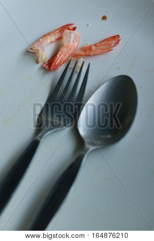 Shrimp Shell Fragments Food On Dish After Eat In White Dish With Fork And Spoon ,still Life Food