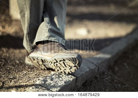 Closeup photo of man feet with trekking shoes