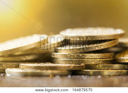 Golden coins closeup - money savings concept