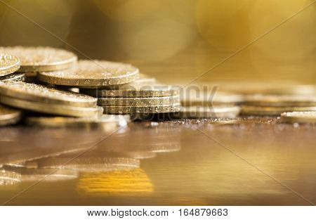 Golden coins - money savings and business concept