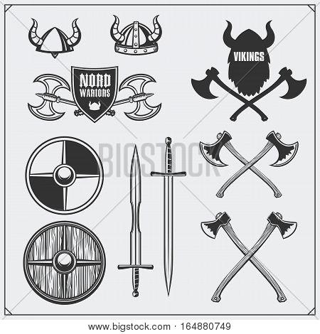 Viking set. Horned helmet, shield, sword and ax. Vintage style.