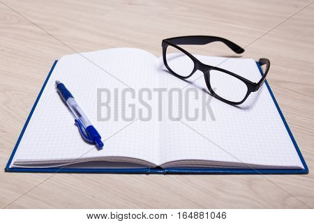 Business, Education Or Creativity Concept - Notebook, Pen And Glasses