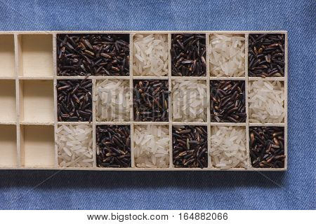 Wild black and white dry rice closeup macro shot on blue jeans, Sensitive focus