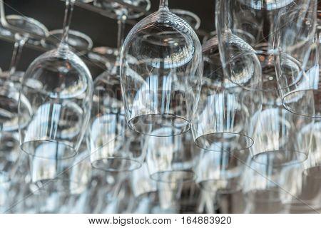 Auckland New Zealand- December 12 2013. Hanging wineglasses in restaurant of New Zealand Sky tower.