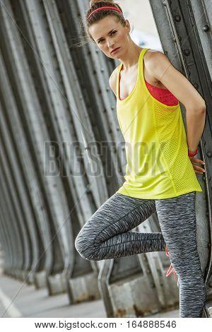 Outdoors fitness in Paris. young sportswoman on Pont de Bir-Hakeim bridge in Paris