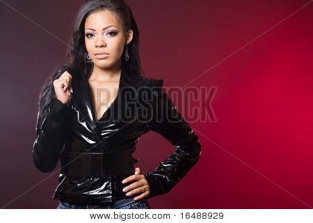 fashionable mulatto woman in a jacket