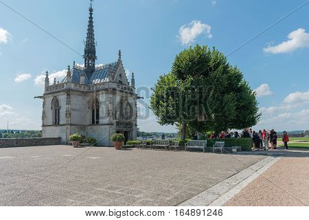 France. Ancient Catholic church and a landscape on the plain