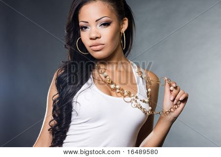 fashionable mulatto woman in a t-shirt