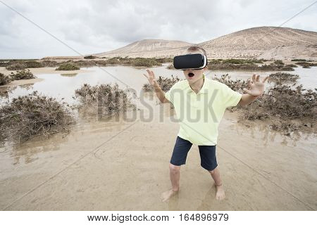 Boy in virtual world with virtual glasses on his head