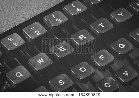 Detail of vintage typewriter qwerty keys in black and white