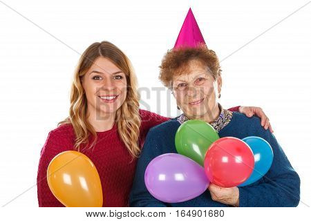 Picture of a senior lady celebrating birthday with her granddaughter