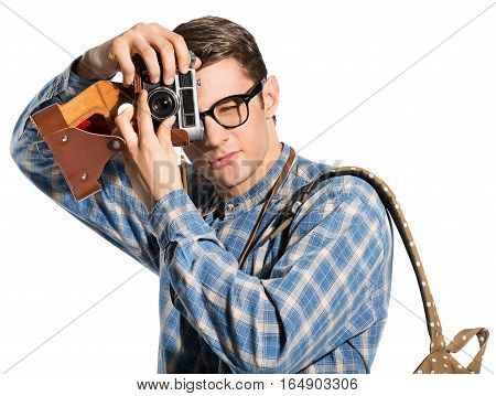 young, handsome man with a camera, dressed in the style of hipster