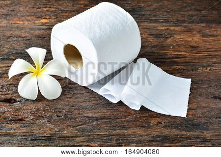 White tissue paper and white flower put on the old bark, wood at the morning