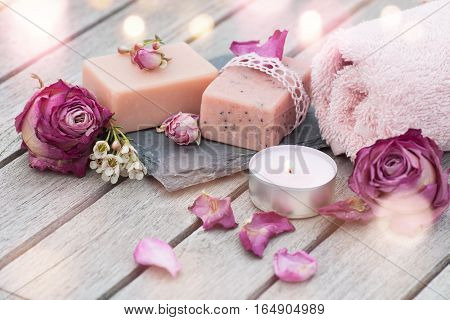 Spa still life with wellness products on a wooden table and bokeh