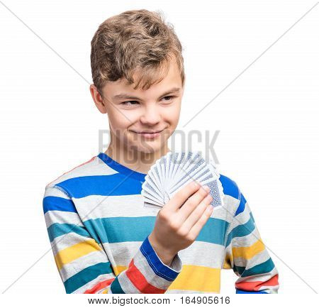 Close up portrait of caucasian teen boy with gamble cards. Handsome guy showing collect cards. Funny cut teenager playing, isolated on white background. Childhood concept -  free time, fun and hobby.