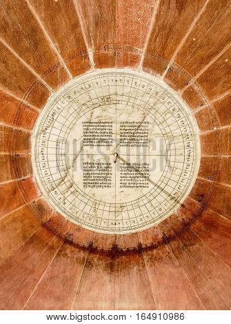 JAIPUR, INDIA - NOVEMBER 18, 2016: A sundial made of marble inlaid with an inscription is located in the royal observatory in Jaipur, India. It is part of a UNESCO World Heritage Site.