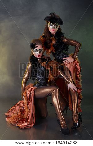 Beautiful young woman in black mysterious venetian mask. Fashion photo
