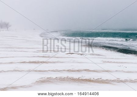View Of The Beach In The Winter During A Snowfall