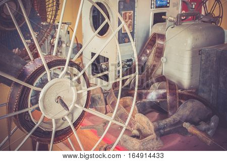Old Equipments Of Vintage Film Projector Used In The Part On The Table.