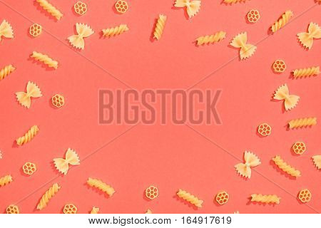 Frame From Wheat Pasta On Red Background