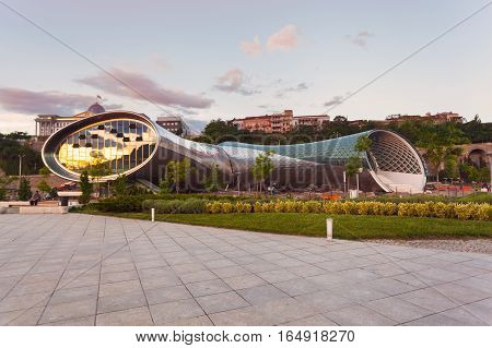 Beautiful view Of Concert Music Theatre Exhibition Hall In Summer Rike Park on the Sunset, Tbilisi, Georgia. Beautiful new park in the city center.