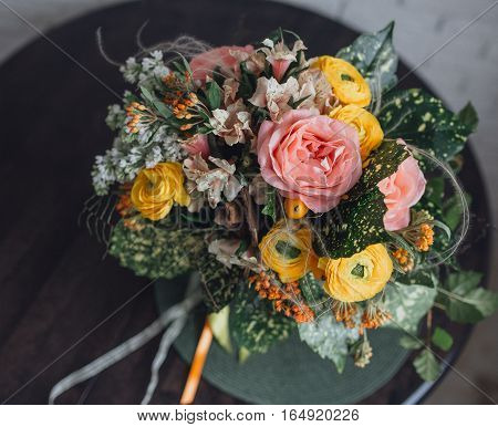 beautiful bridal bouquet of different flowers on the table