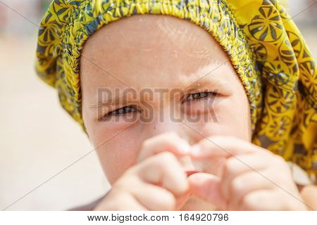 Boy showing his hands with heart symbol