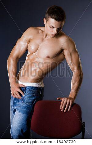 young bodybuilder man on black background