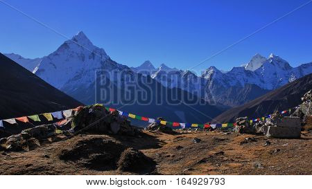 Scene in the Everest National Park Nepal. Majestic mount Ama Dablam. Buddhist prayer flags.