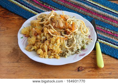 Plate of rice potatoes noodles and chicken typical Peruvian Sierra lunch and dinner meal