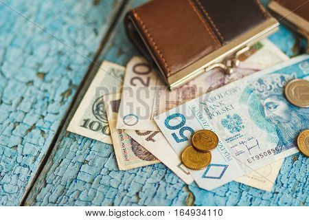 Polish Zloty With A Wallet On The Wooden Background