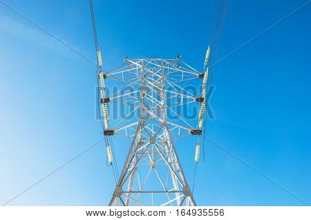 Power transmission line on the sky background