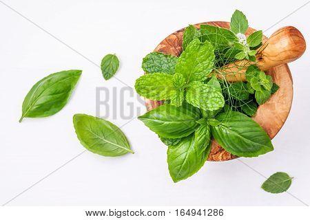 Alternative Medicine Fresh Herbs In The Wooden Mortar . Food Ingredients And Seasoning Basil, Pepper