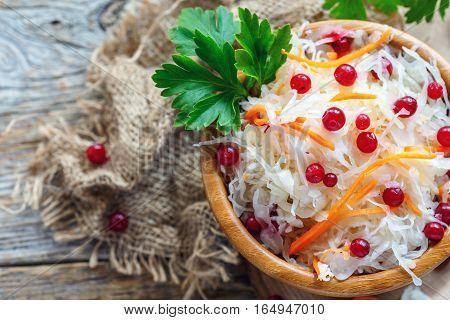 Crispy Sauerkraut With Cranberries In A Wooden Bowl.