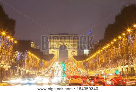 The Triumphal Arch and Champs Elysees avenue illuminated for ChristmasParis France.