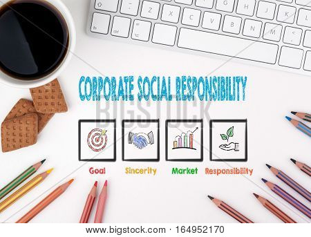 Corporate Social Responsibility, Business concept. White office desk Computer keyboard, coffee mug and colored pencils