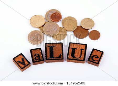Value. Wooden letters and money on a white background.