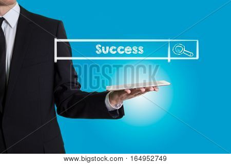 Success, young man holding a tablet computer. Light blue background