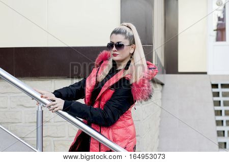 the woman in a pink jacket rises in office a subject beautiful women