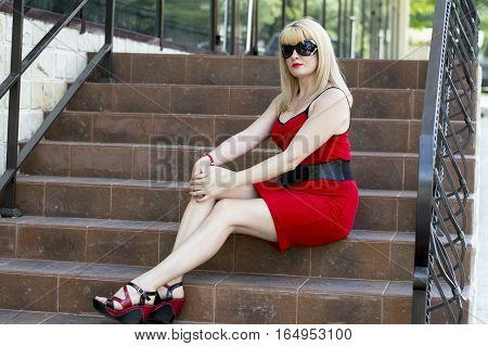 the tired business woman sits on the steps of office a subject beautiful women and business