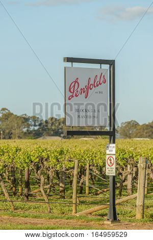 PENOLA SOUTH AUSTRALIA - OCTOBER 27 2016: Sign at entrance to Penfolds vineyards in Coonawarra in South Australia in spring evening sunlight.