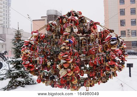 A symbol of love lock hung on a tree and throw the key. Kazan. Russia